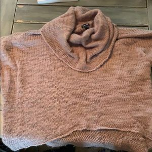 Short sleeve cowl neck sweater.
